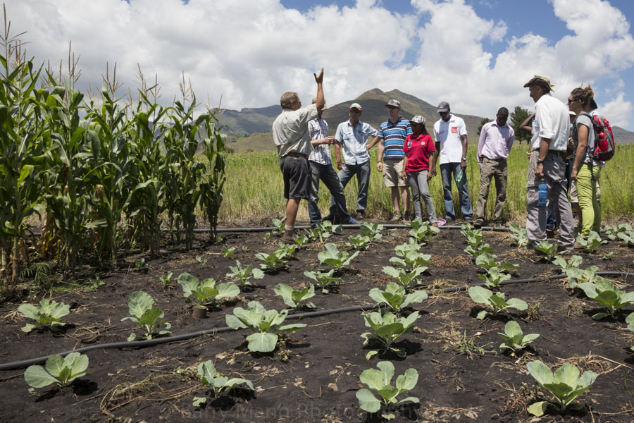 August Basson teaching Growing Nations Farming Quest participants in the fields at Mpharane, Lesotho
