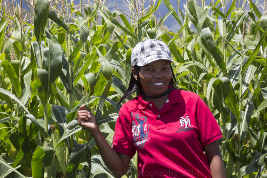 Growing Nations extension officer, Ke-Ke' stands proudly in front of the maize in her demonstration fields in Mpharane, Lesotho