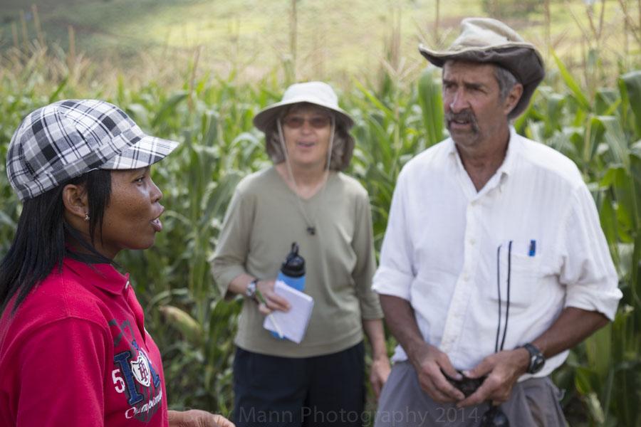 Growing Nations extension officer, Ke-Ke' teaching Farming Quest participants in the fields